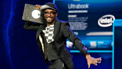 PHOTO: Entertainer will.i.am, Intel Corp.'s director of creative innovation, makes a joke about his Ultrabook being the new &quot;ghetto blaster&quot; during an Intel Corp. presentation at the 2012 International Consumer Electronics Show (CES) in Las Vegas, Nevada,