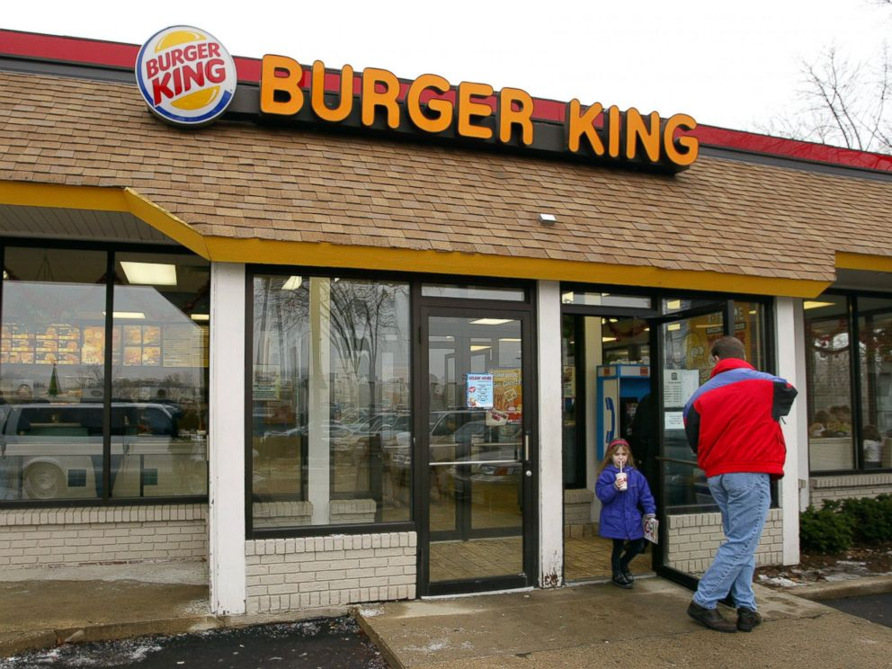 PHOTO: Customers leave a Burger King restaurant December 13, 2002 in Park Ridge, Illinois.