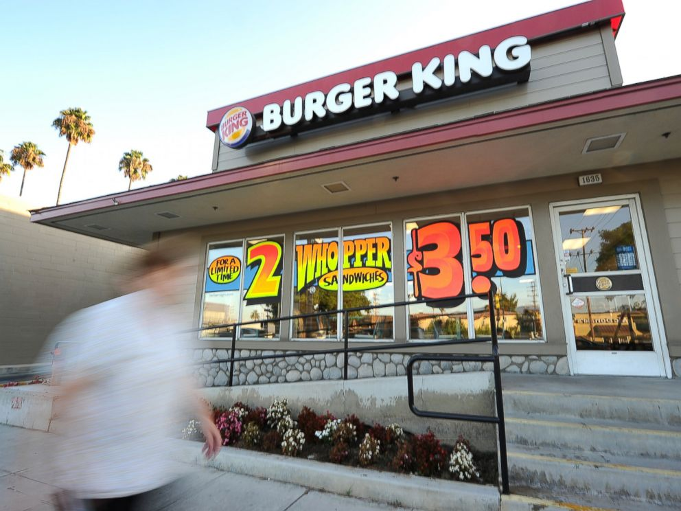 PHOTO: A man walks past a Burger King restaurant in Glendale, California on Sept. 2, 2010.