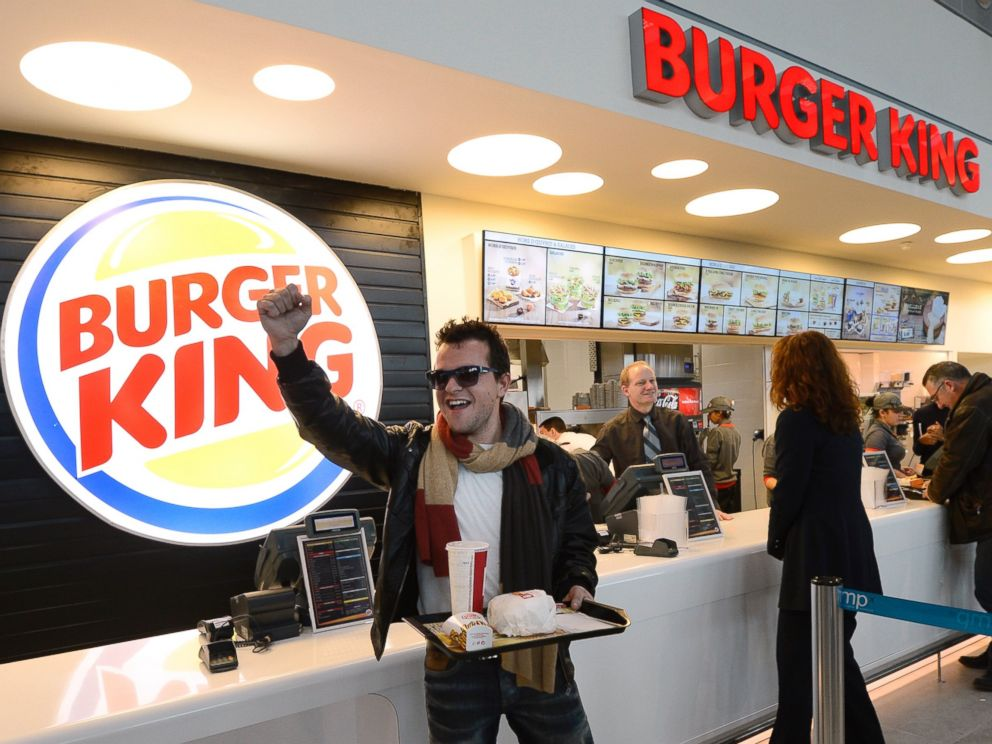 PHOTO: A customer reacts after being served at the Burger King fast food restaurant in Marseilles airport, in Marignane, southern France, on Dec. 22, 2012.