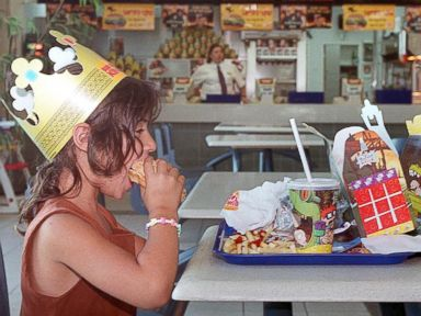 PHOTO: Jewish settler children enjoy a Burger King meal in the West Bank settlement of Maale Adumim, Aug. 9, 1999.