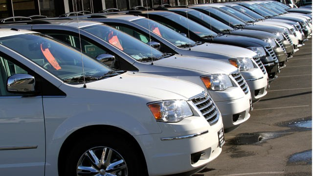 PHOTO: Chrysler minivans are lined up for sale on the lot of South Bay Chrysler Jeep Dodge dealership in Torrance, Calif., Jan. 31, 2011.