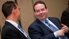 PHOTO: Marc Casper, president and chief executive officer of Thermo Fisher Scientific Inc., right, speaks with Greg Herrema, the company's senior vice president, during a press conference at the Pittcon 2010 Exposition in Orlando, Florida, U.S., on March,