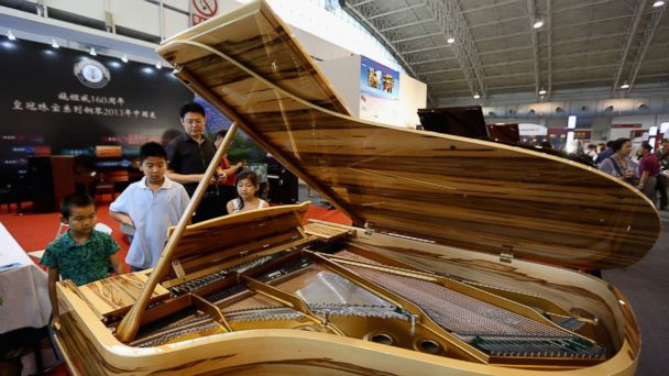 PHOTO: The potential consumers visit the Steinway & Sons piano zone at the Luxury China 2013 exhibition on June 22, 2013 in Beijing.