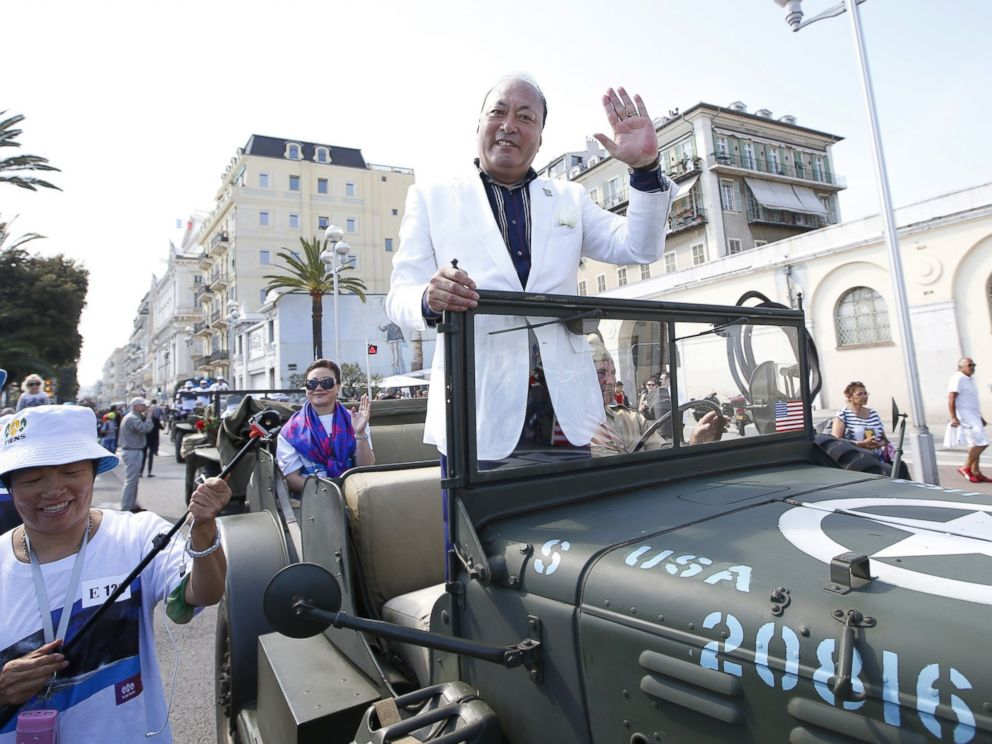 PHOTO: Li Jinyuan, CEO of Tiens rides in a parade on May 8, 2015 in Nice, France as part of the two-day celebration weekend for the 20th anniversary of his company.
