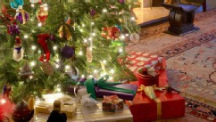 PHOTO: Christmas presents are seen under a tree.