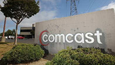 PHOTO: 	A sign stands in front of a Comcast customer service center in San Rafael, Calif.