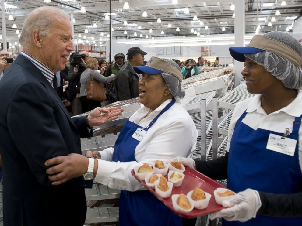 PHOTO: Vice President Joe Biden tries food samples during a visit to a Costco store on a shopping trip in Washington, DC, on Nov. 29, 2012.