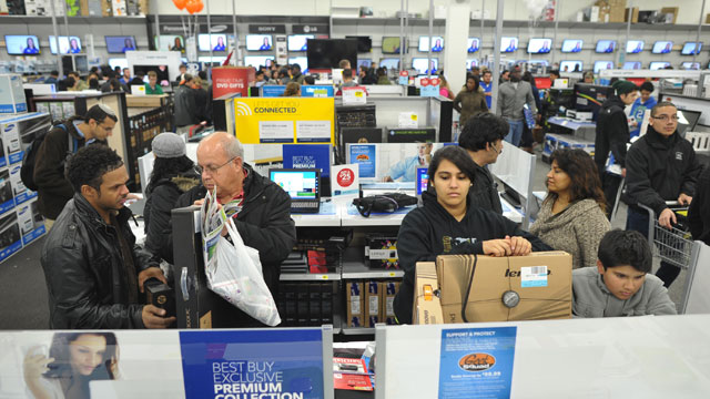 PHOTO: Shoppers look at laptop computers inside a Best Buy store which began their Black Friday sale at midnight on Nov. 22, 2012 in Rockville, Md.