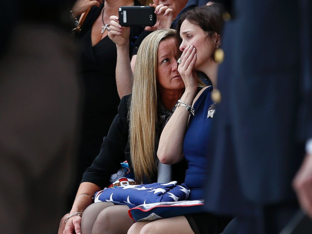 PHOTO: Family members console Kathleen Goforth, the widow of Harris County Sherrif Deputy Darren Goforth, following his funeral at Second Baptist Church on Sept. 4, 2015, in Houston, Texas.