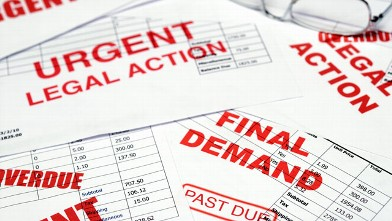 PHOTO: With many Americans struggling to pay their bills one business is booming: debt collectors.