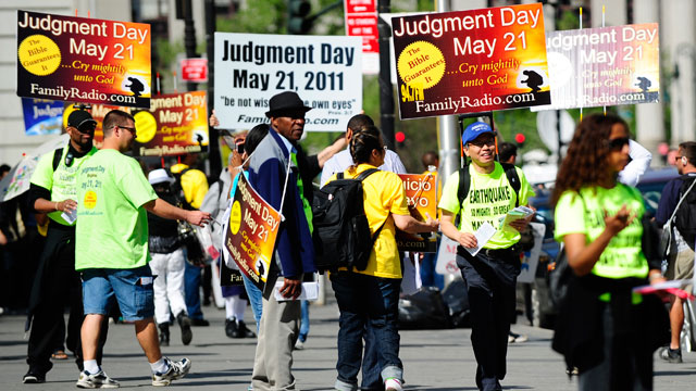 "PHOTO: Activists believing that ""Judgement Day"" will happen on May 21, 2011, spread their word near M"