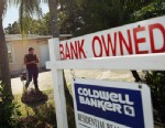 PHOTO: Renzo Salazar maintains the yard around a foreclosed home after the bank hired him to keep the home from falling into complete dilapidation on November 10, 2011 in Miami, Florida.