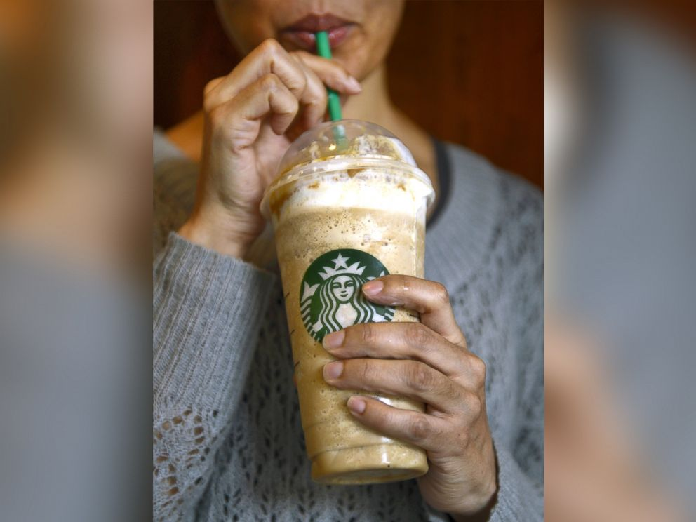 PHOTO: A woman takes a drink from a 26-ounce Caramel Frappuccino at a Starbucks on the Upper East Side of New York, March 11, 2013.