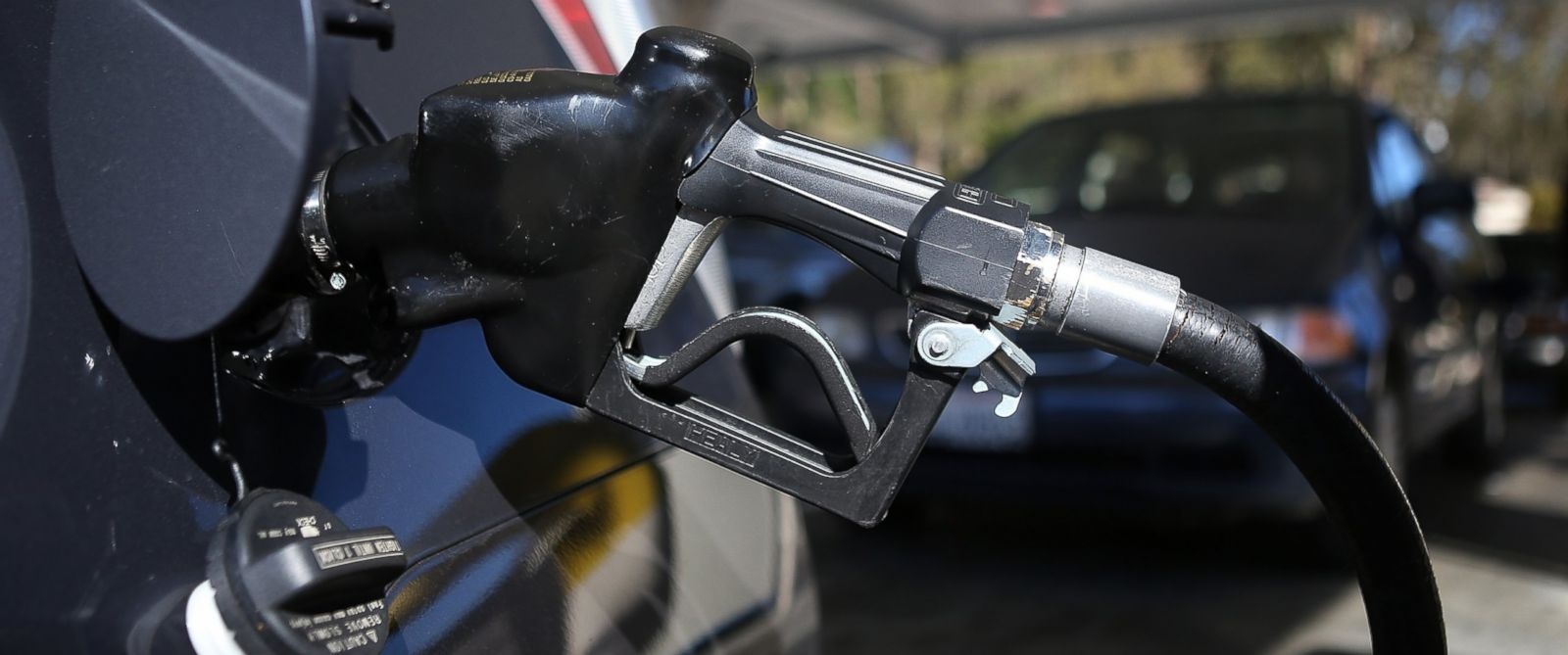 PHOTO: A gas pump nozzle sits in a car at a gas station in San Francisco, Calif.