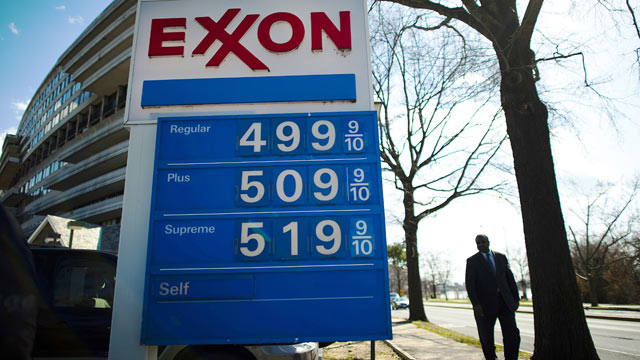 PHOTO: A man walks past a service station displaying its gasoline price in Washington, DC, March 1, 2012.