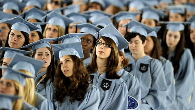 PHOTO: Graduates listen to US President Barack Obama as he delivers the Commencement Address at Barnard College's graduation ceremony in New York on May 14, 2012.