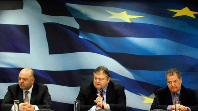 PHOTO: Evangelos Venizelos, Greece's finance minister, center, speaks while George Zanias, chairman of Greece's council of economic advisors, left, and Pantelis Economou, Greece's deputy finance minister, listen during a news conference, Athens, Greece, F