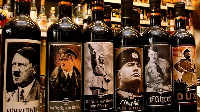 PHOTO: Bottles of Lunardelli wine with labels depicting Adolf Hitler and Benito Mussolini are displayed in a wine shop September 2003, in Bibbione near Venice, Italy.