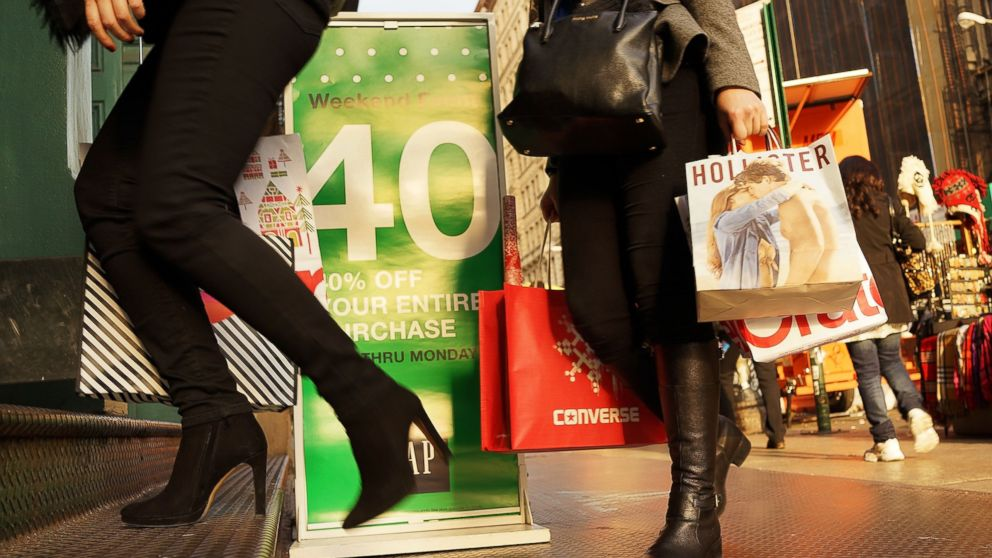 PHOTO: People carry shopping bags along Broadway on Dec. 2, 2013 in New York City.