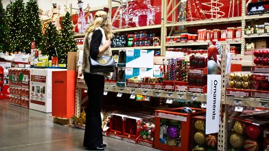 PHOTO: A customer shops in the holiday decorations area at a Home Depot in this Nov. 11, 2011 file photo.
