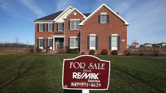 PHOTO: A home is offered for sale by Remax Realty in a Toll Brothers housing development on December 4, 2012 in South Barrington, Illinois.