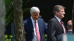 PHOTO: Jamie Dimon, chairman and CEO of JPMorgan Chase, left, and an unidentified man leave the company's annual shareholders meeting in Tampa, Fla., May 21, 2013.