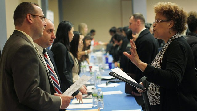 PHOTO: Job seekers speak with perspective employers at the New York Career Fair held at a midtown Holiday Inn in this Dec. 12, 2011 file photo in New York City.