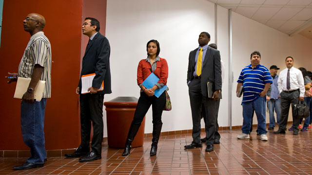 PHOTO: Job seekers wait for the opening of an employment fair sponsored by Job News in partnership with USOilWorker.com and The Texas Veterans Commission at the Norris Conference Center in San Antonio, Texas, March 19, 2013.