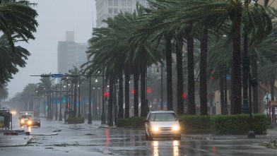 PHOTO: A vehicle travels down Canal Street as Hurricane Isaac dumps heavy rain on August 29, 2012 in New Orleans, La.