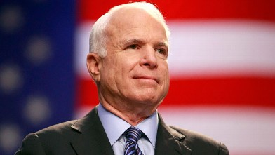 PHOTO: Republican presidential candidate Sen. John McCain (R-AZ) applauds during a campaign rally at the Virginia Beach Convention Center October 13, 2008 in Virginia Beach, Virginia.