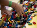 PHOTO: A child plays with LEGO building blocks while visiting the National Building Museum in Washington, D.C., Aug. 10, 2010.