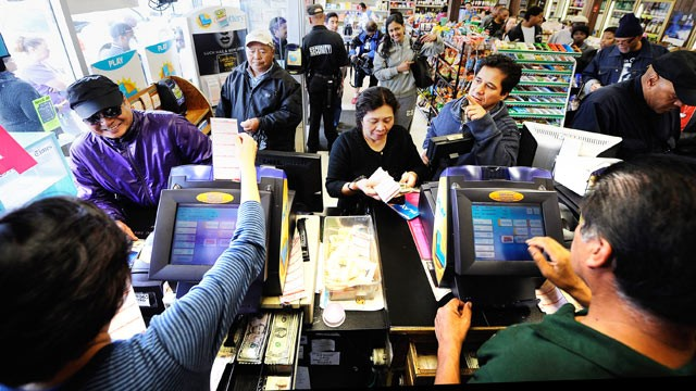 PHOTO: Customers wait in line to buy their Mega Millions tickets at Bluebird liquor store, March 29, 2012 in Hawthorne, Calif.