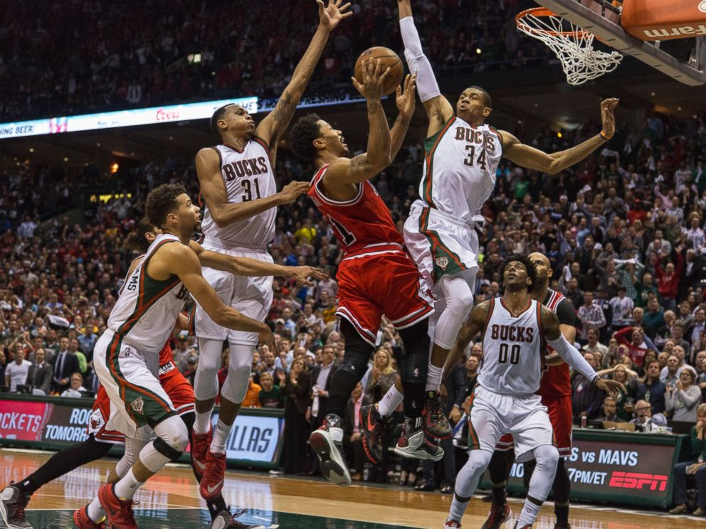 PHOTO: Derrick Rose of the Chicago Bulls shoots against guard Giannis Antetokounmpo #34 of the Milwaukee Bucks during game three of the NBA Playoffs, April 23, 2015 in Milwaukee, Wis.