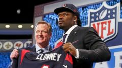 PHOTO: NFL Commissioner Roger Goodell stands with Jadeveon Clowney after he was picked in the 2014 NFL Draft at Radio City Music Hall on May 8, 2014 in New York City.