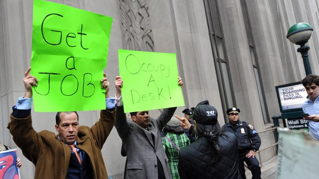 PHOTO: Derrick Tabacco, left, a small business owner, and an unidentified man counter demonstrate against the 'Occupy Wall Street' march near the New York Stock Exchange, Nov. 17, 2011 in New York.