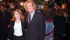 "PHOTO: Actor Nick Nolte(R), who has a role in the film ""The Thin Red Line,"" arrives to the premiere of the movie with television actress Vicky Lewis(L) 22 December in Beverly Hills. The film also stars Sean Penn, who did not attend the premiere."
