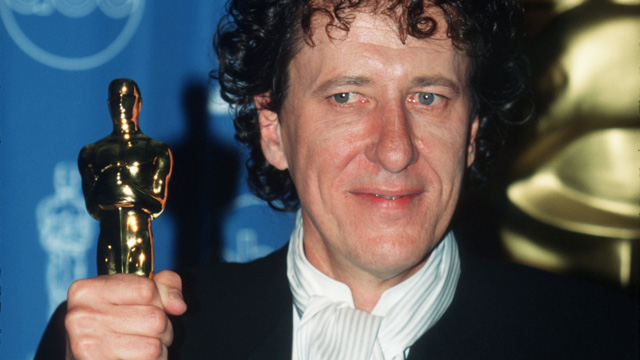 "PHOTO: Geoffrey Rush holds his award for Best Performance By An Actor In A Leading Role for the film ""Shine"" backstage at the 69th Annual Academy Awards ceremony March 24, 1997 in Los Angeles, CA."