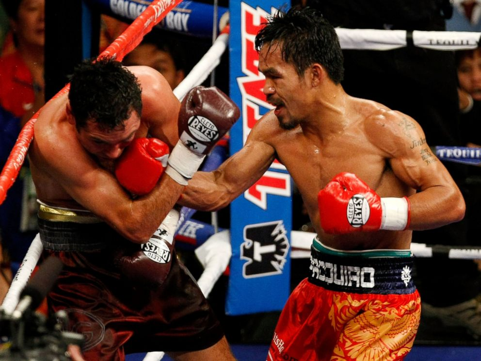 PHOTO: Manny Pacquiao of the Philippines fights Oscar De La Hoya during their welterweight match at the MGM Grand Garden Arena, Dec. 6, 2008 in Las Vegas, Nev.