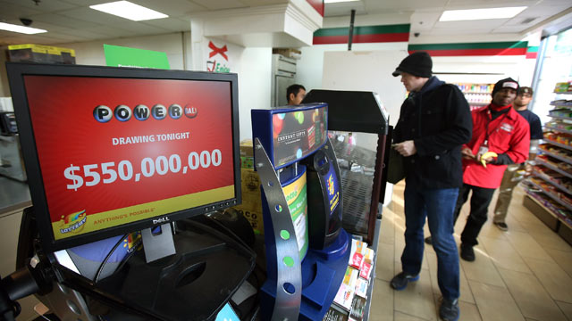 PHOTO: Customers purchase Powerball lottery tickets at a 7-Eleven store, Nov. 28, 2012 in Chicago, Illinois.