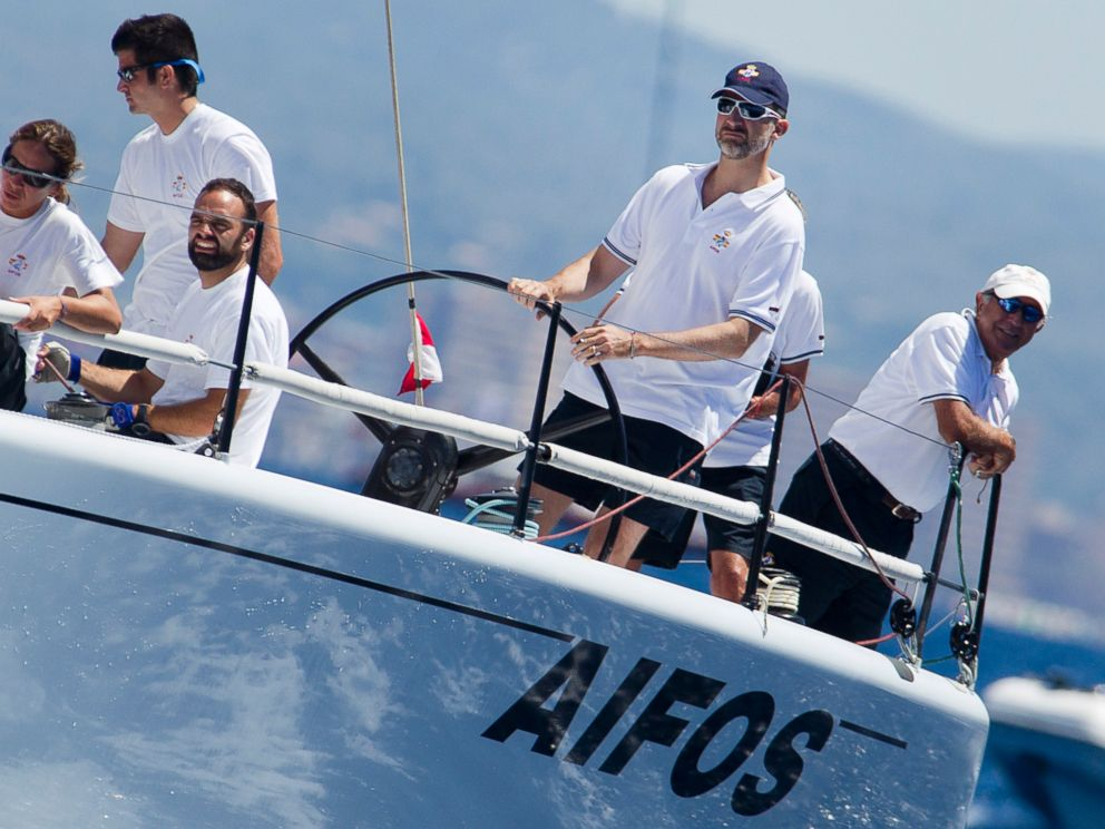 PHOTO: Spains Crown Prince Felipe, second right, steers the Aifos sailboat during the 32nd Copa del Rey Regatta off the coast of Palma de Mallorca on July 31, 2013.