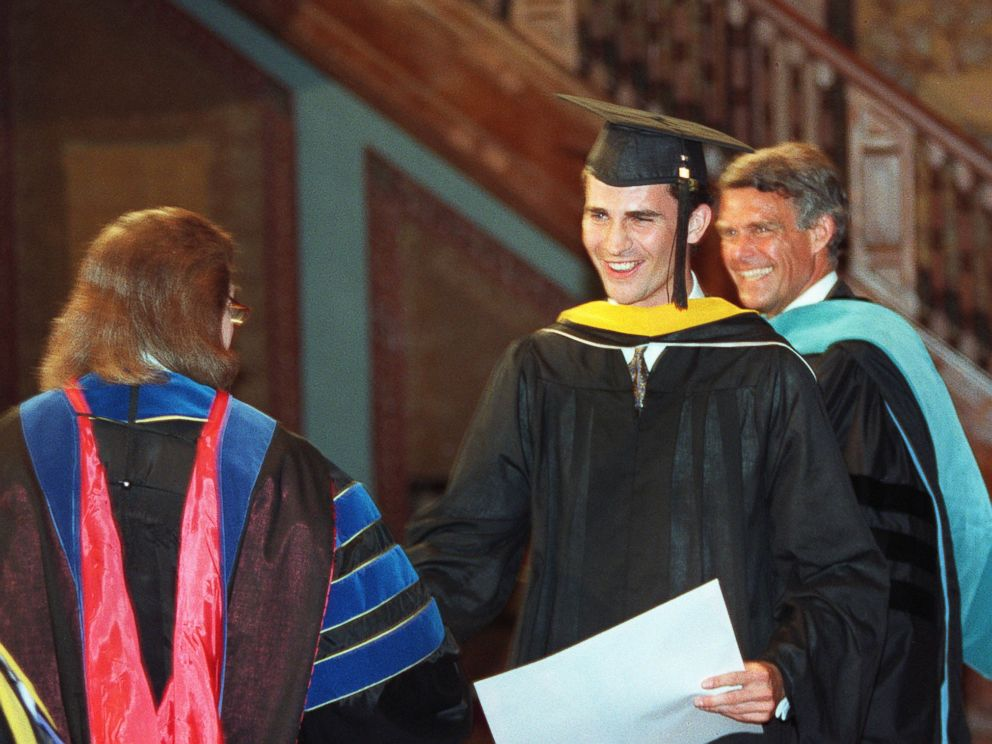 PHOTO: Prince Felipe (C) of Spain is congratulated by Dr. Sally Anne Baynard (L), a lecturer at Georgetown University, and Dean of Foreign Service Peter Krogh (R) at Georgetown University, May 26, 1995.
