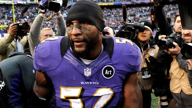 PHOTO: Ray Lewis of the Baltimore Ravens is mobbed by the media after defeating the Indianapolis Colts, Jan. 6, 2013 in Baltimore, Md.