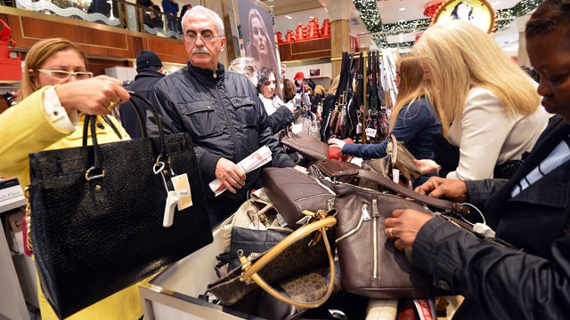 PHOTO: People shop on the first floor of Macy's department store, Nov. 23, 2012 in New York.