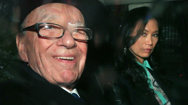 PHOTO: Rupert Murdoch leaves The Royal Courts of Justice with his wife Wendi Deng Murdoch after giving evidence to The Leveson Inquiry, April 25, 2012 in London.
