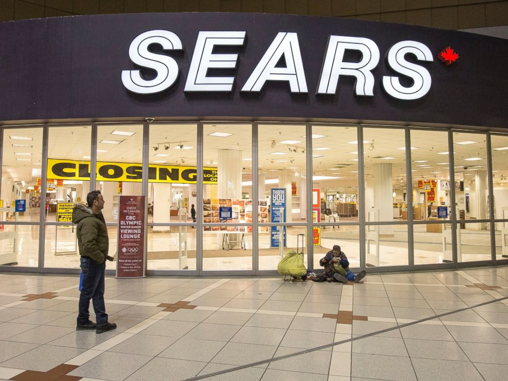 PHOTO: The doors of the Sears at the Eaton Centre mall are seen closed for the last time on Feb. 23, 2014 in Toronto.
