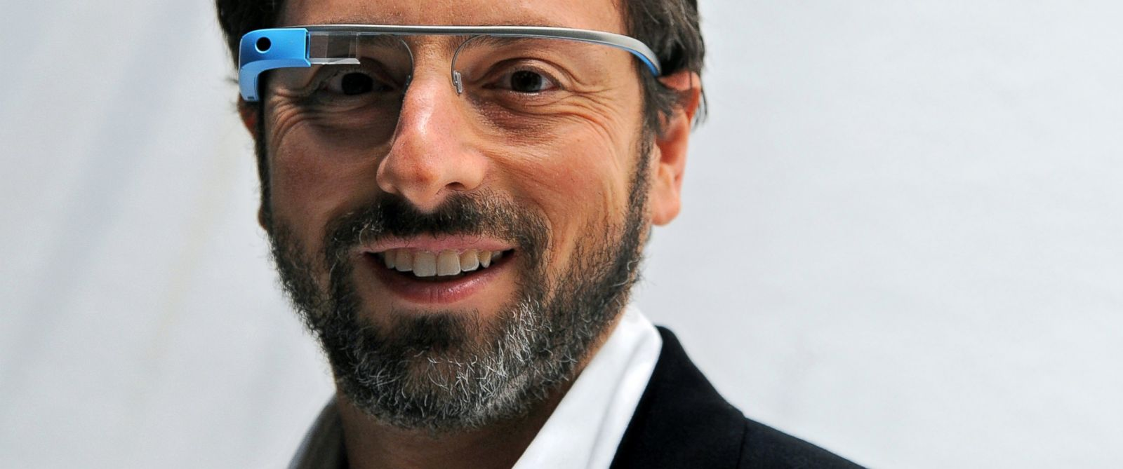 PHOTO: Sergey Brin, co-founder of Google Inc., stands for a photograph while wearing Project Glass internet glasses at the Diane Von Furstenberg fashion show in New York, U.S., on Sept. 9, 2012.