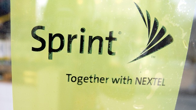 PHOTO: A Sprint Nextel Corp. sign sits on the door at the retail store in New York, Feb. 19, 2009.