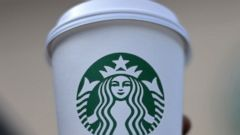 PHOTO: A woman holds a Starbucks coffee cup in this file photo, March 28. 2013, in Silver Spring, Md.