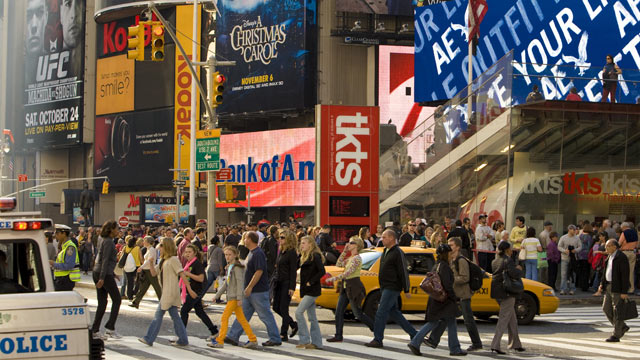 PHOTO: Traffic and people along 7th Avenue near Broadway and Times Square are seen against a backdrop of advertising billboards in this New York, NY, early afternoon cityscape photo, 2009.